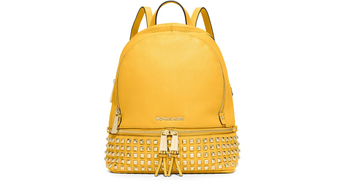 845e4a39d061 ... switzerland lyst michael kors michael rhea small studded backpack in  yellow 4f2ae e3da7