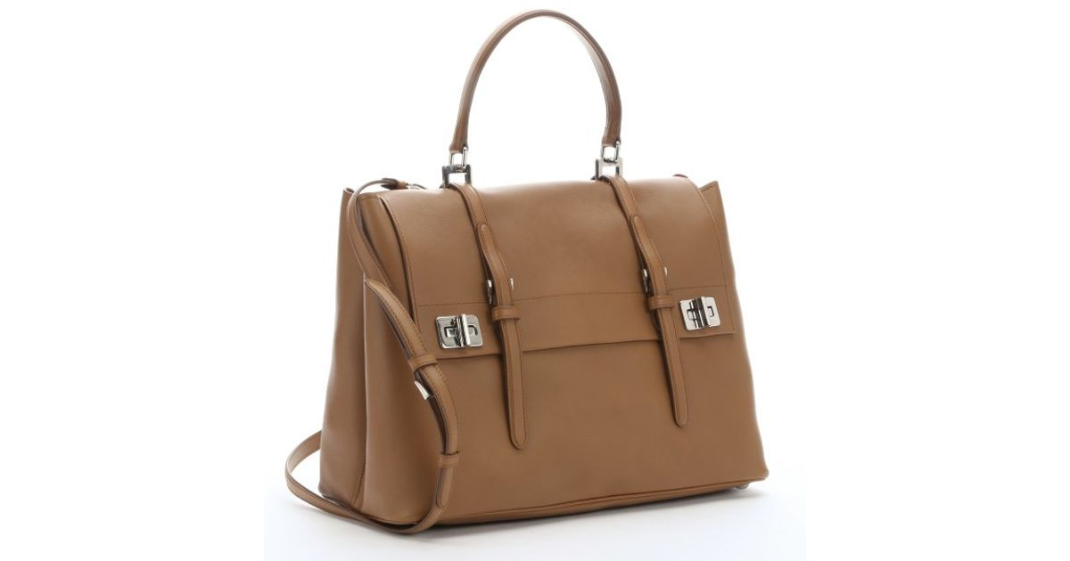 3cf082ab9cd7 ... reduced prada caramel leather buckle accent convertible top handle bag  in brown lyst 09682 addb0