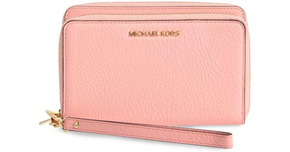 michael michael kors 39 adele 39 leather wristlet in pink lyst. Black Bedroom Furniture Sets. Home Design Ideas