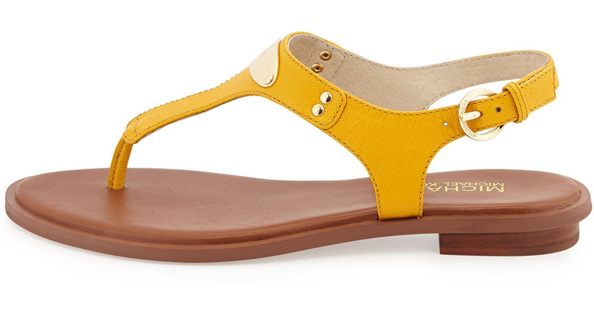 15a2cde29cc0 MICHAEL Michael Kors Plate Thong Sandals in Yellow - Lyst