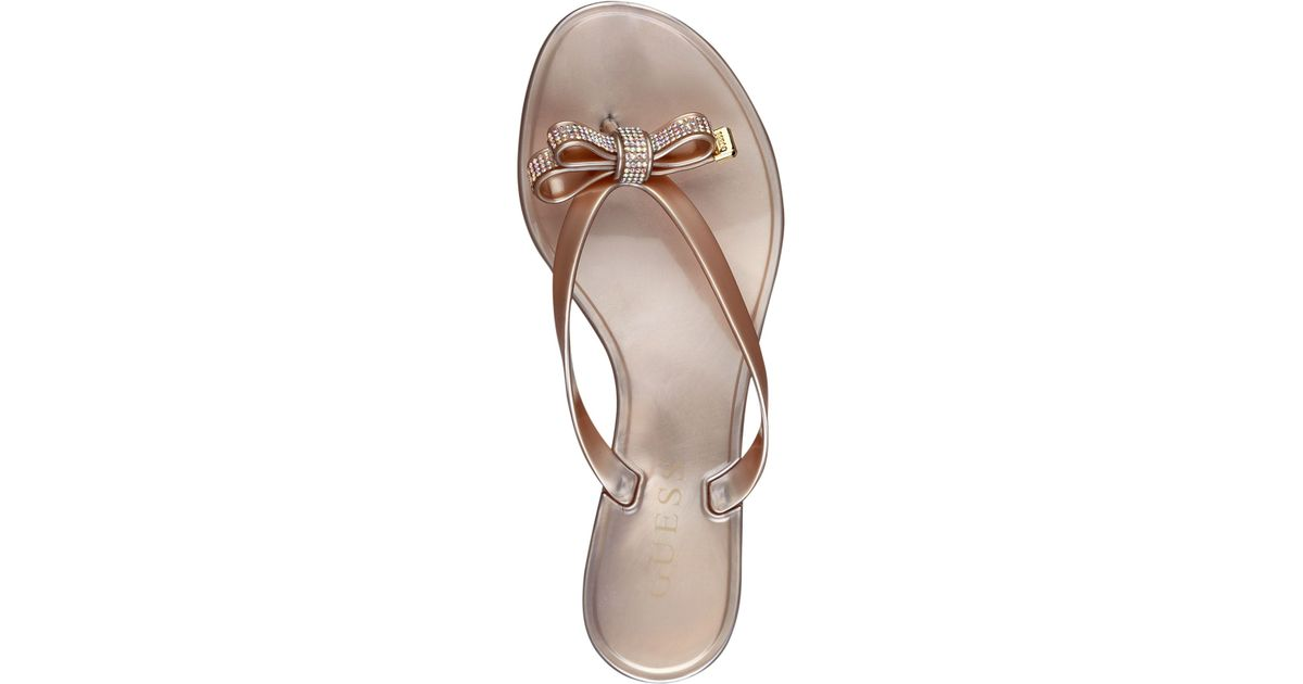 c3fca05a0889ca Lyst - Guess Jelsie Bow Jelly Flip Flops in Pink