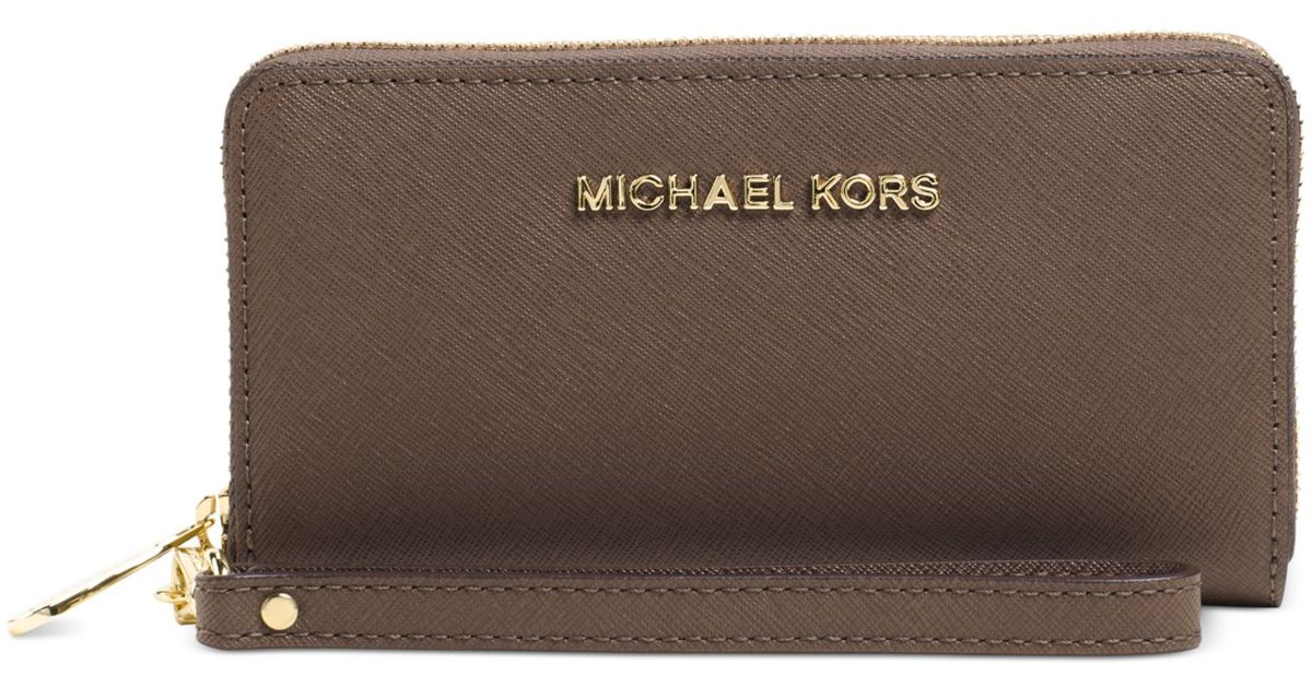 83f8e3895ed5 Lyst - Michael Kors Michael Jet Set Travel Large Coin Multifunction Phone  Case in Brown