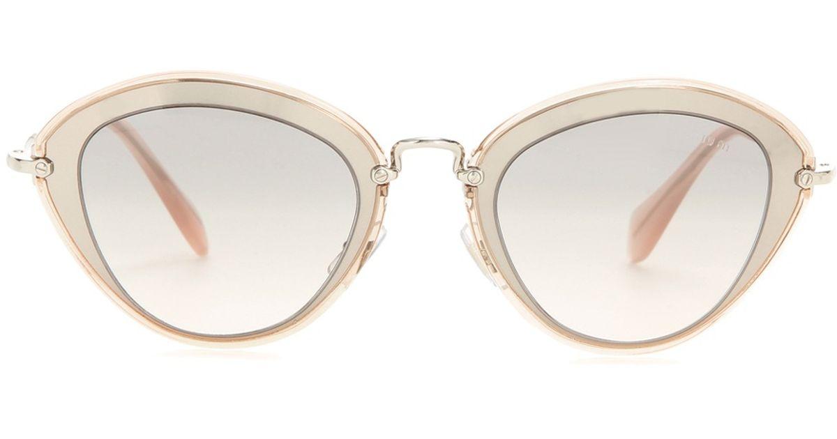 c6992a07797 Miu Miu Cat Eye Sunglasses Pink