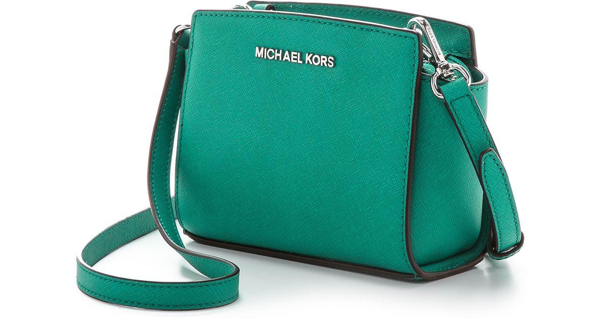 f1a1f10773ce ... coupon for michael michael kors selma mini messenger aqua in blue lyst  64867 137a6