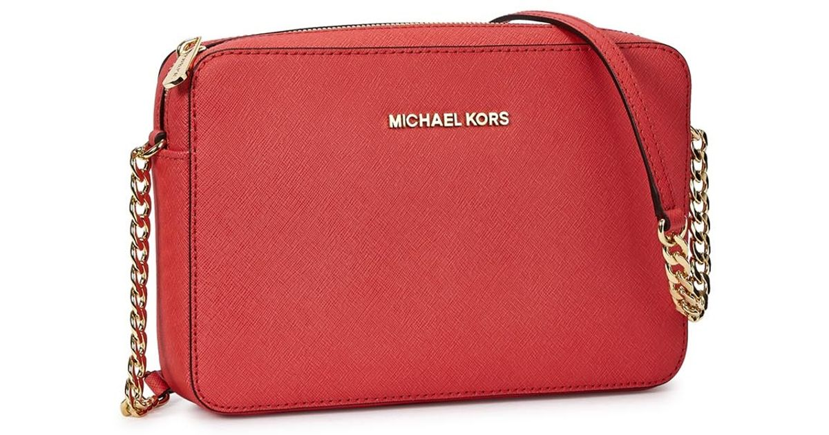 54e23020cc1d Michael Kors Jet Set Travel Coral Leather Cross-Body Bag in Red - Lyst