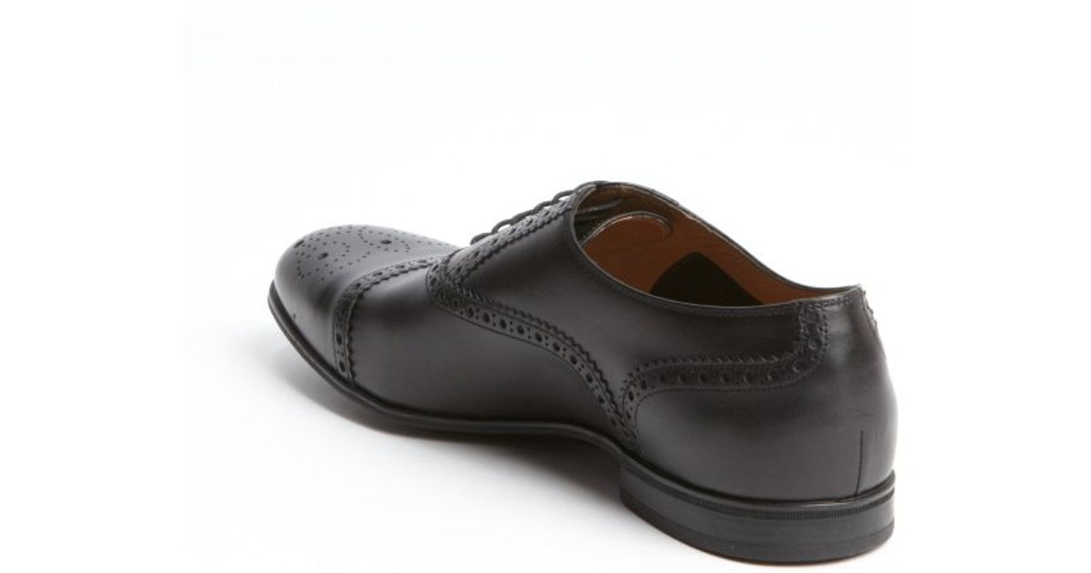 gucci black leather cap toe tooled lace up oxfords in