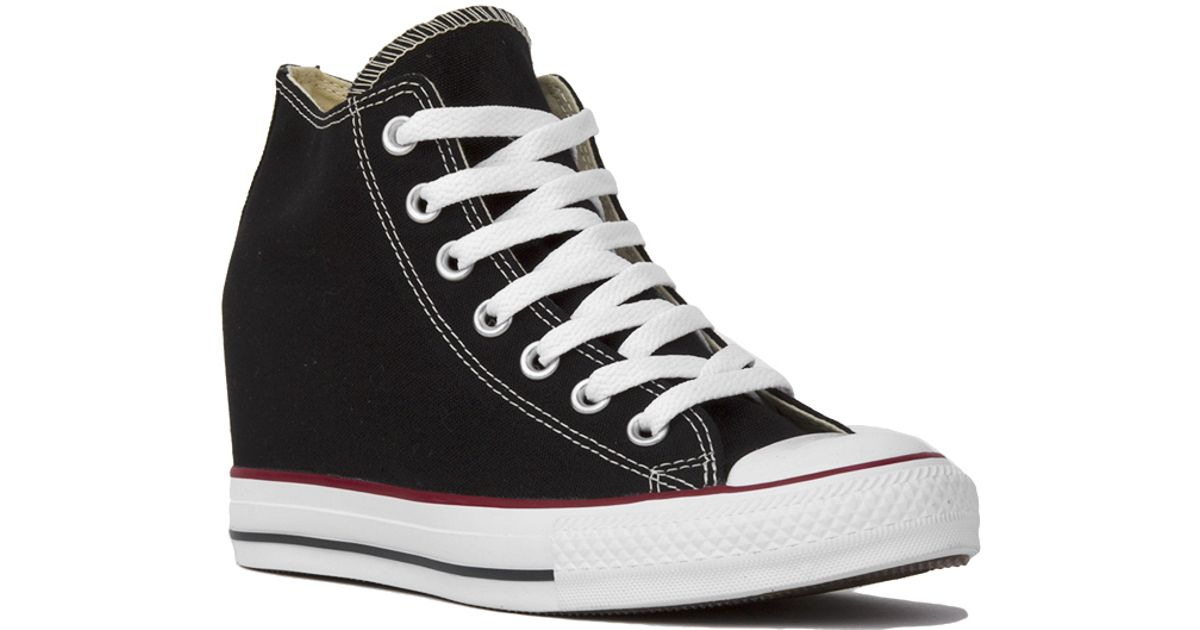 2aa6f2d7144c Lyst - Converse Women s Chuck Taylor All Star Lux Mid Top Sneaker Wedges in  Black