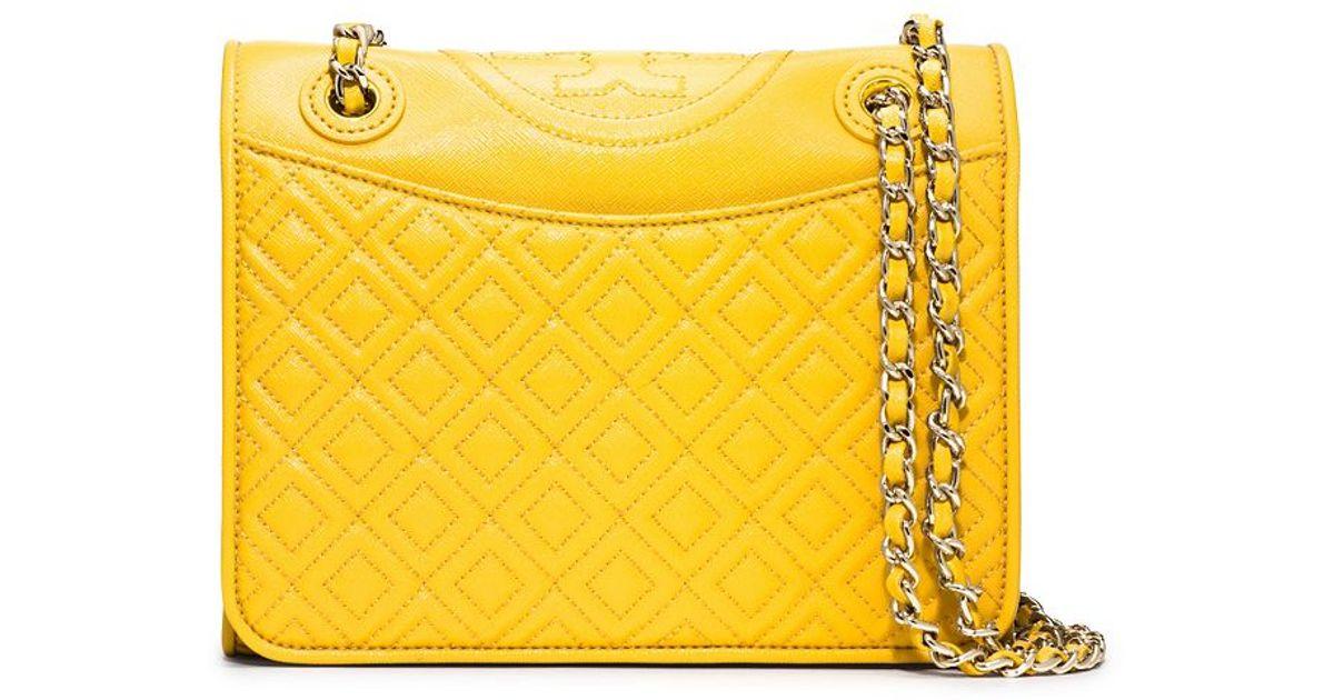 4b91a78c3e Tory Burch Fleming Patent Medium Bag in Yellow - Lyst