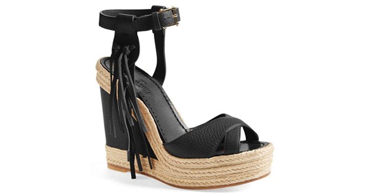 67fb129f46af8 Lyst - Valentino  rockee  Fringe Wedge Sandal in Black