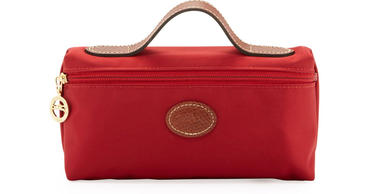 510764f13fd Lyst - Longchamp Le Pliage Cosmetic Case in Red