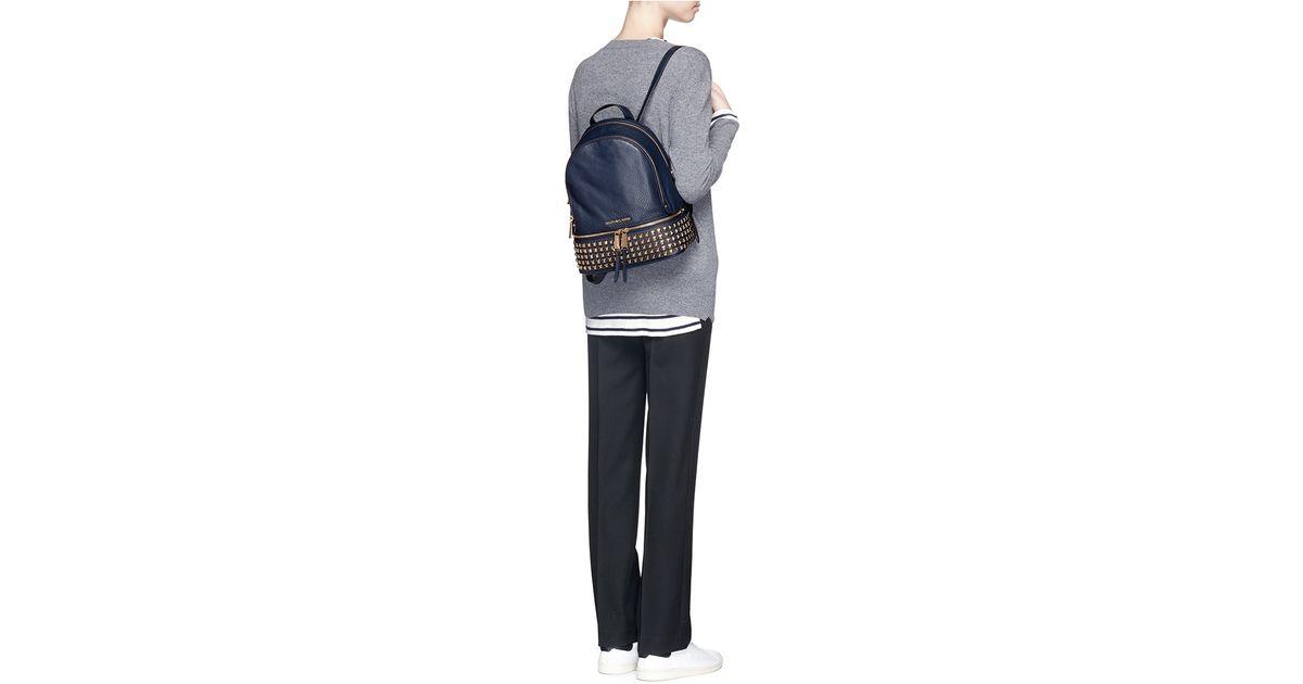 71ba4170b4a03a ... australia michael kors rhea small stud leather backpack in blue lyst  76947 5a079