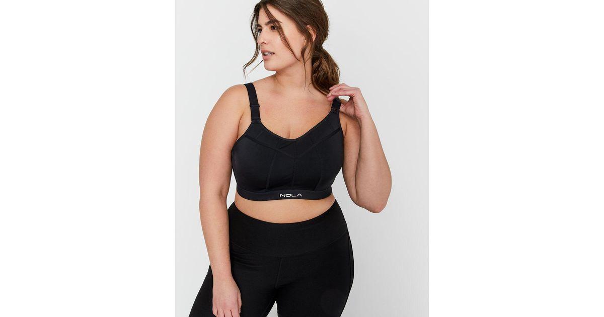 1643844519b8f Lyst - Addition Elle Nola Padded Wire Sports Bra In Sizes G   H in Black