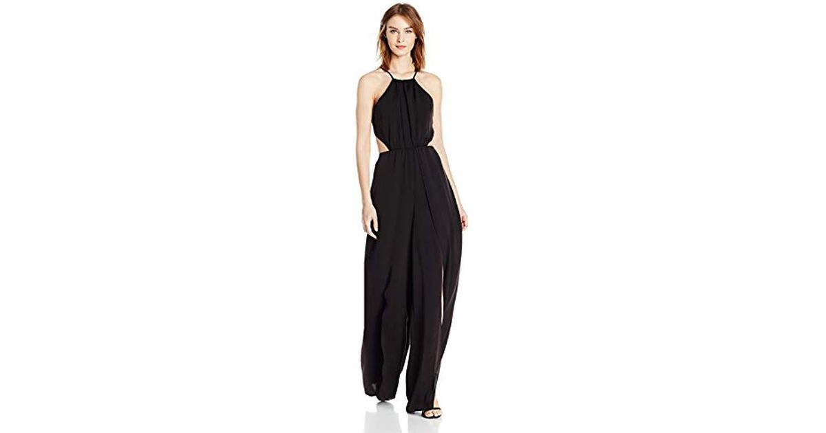 8b3d5b71c8a7 Lyst - Halston Halter Neck Flowy Jumpsuit With Leg Slits in Black