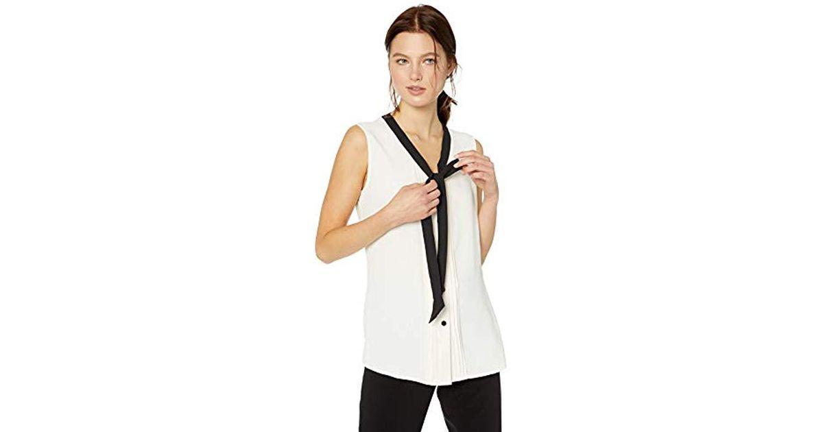 e5b382acd6921 Lyst - Anne Klein Sleeveless V-neck Bow Blouse in White - Save 72%