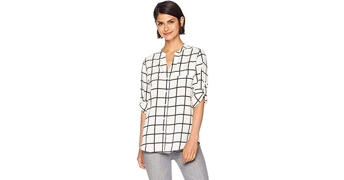 b257c52c4 Lyst - Calvin Klein Printed Split Neck Roll Sleeve Blouse in White