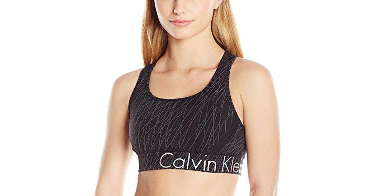 8ade441d6eb3 Lyst - Calvin Klein 205W39Nyc Performance Snake Charmer And Nova Glow Print  Large Logo Sports Bra in Black