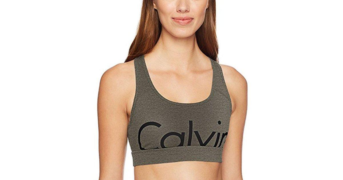 3f8d35ecff3 Lyst - Calvin Klein Performance Large Cut Off Logo Racerback Bra