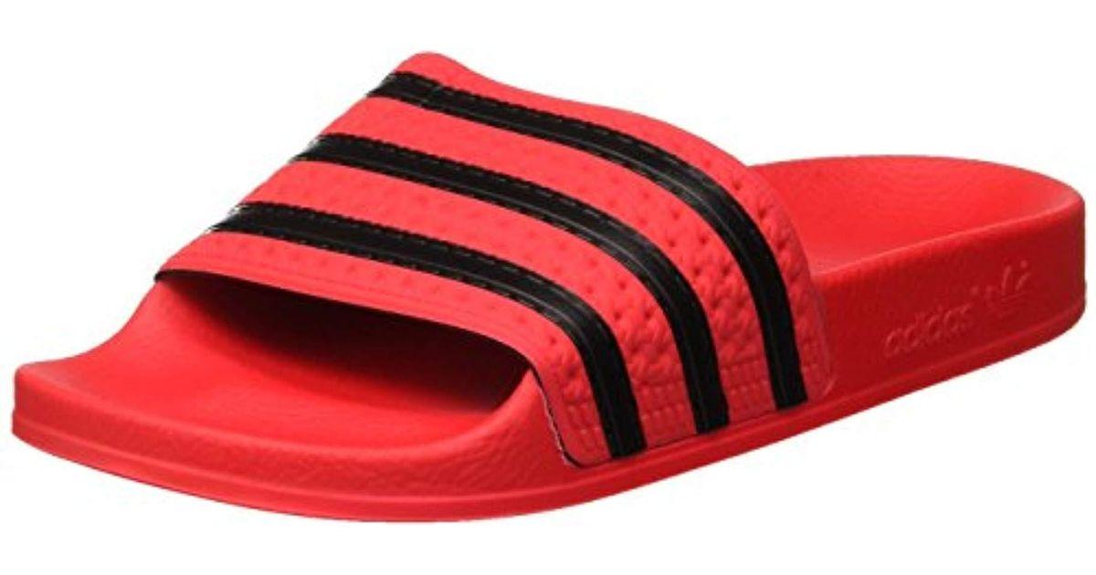 competitive price 46f83 145ba Adilette, Pantoufle Homme adidas pour homme en coloris Rouge - Lyst