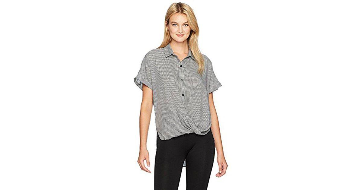 4708f4690ca3 Lyst - BCBGeneration Wrap Hem Dolman Sleeve Shirt