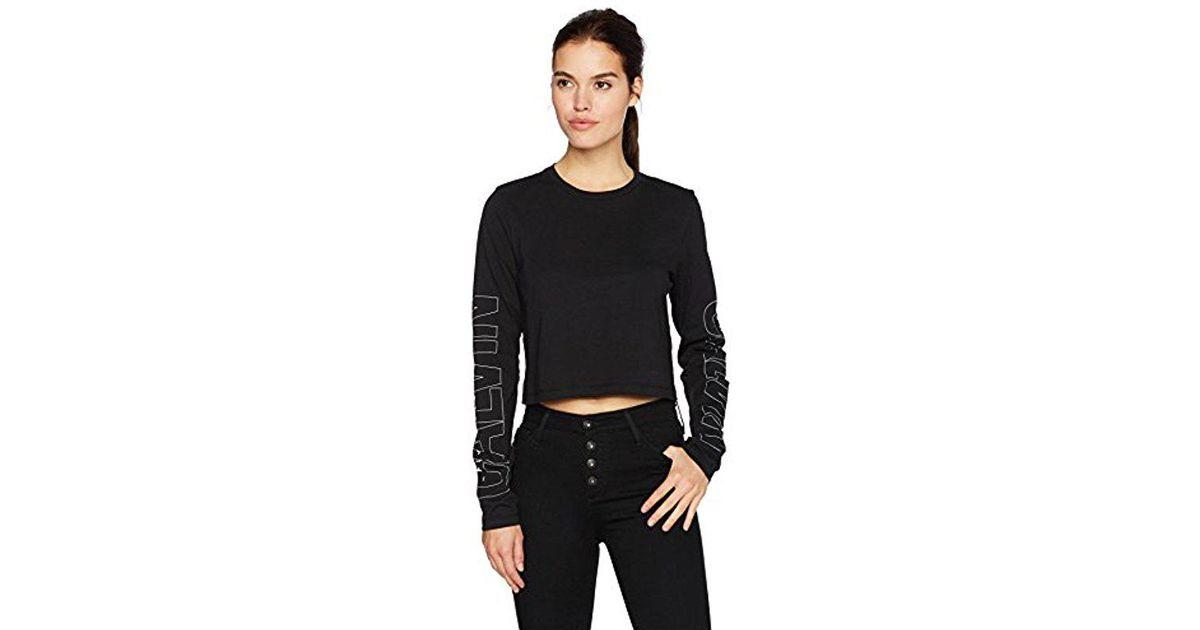 e9e35dc375fcb Lyst - Calvin Klein Long Sleeve Cropped Calvin Logo Tee in Black - Save 10%