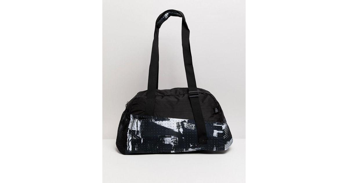 c623a476258786 Reebok Enhanced Lead And Go Graphic Grip Bag in Black - Lyst