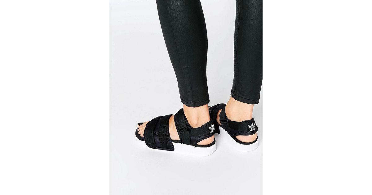 b58f80f71fe3 Lyst - adidas Originals Originals Adilette Chunky Strap Sandal Flat Sandals  in Black