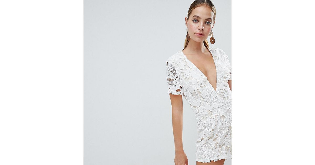 f44f59ab462d Lyst - Missguided Plunge Lace Playsuit in White
