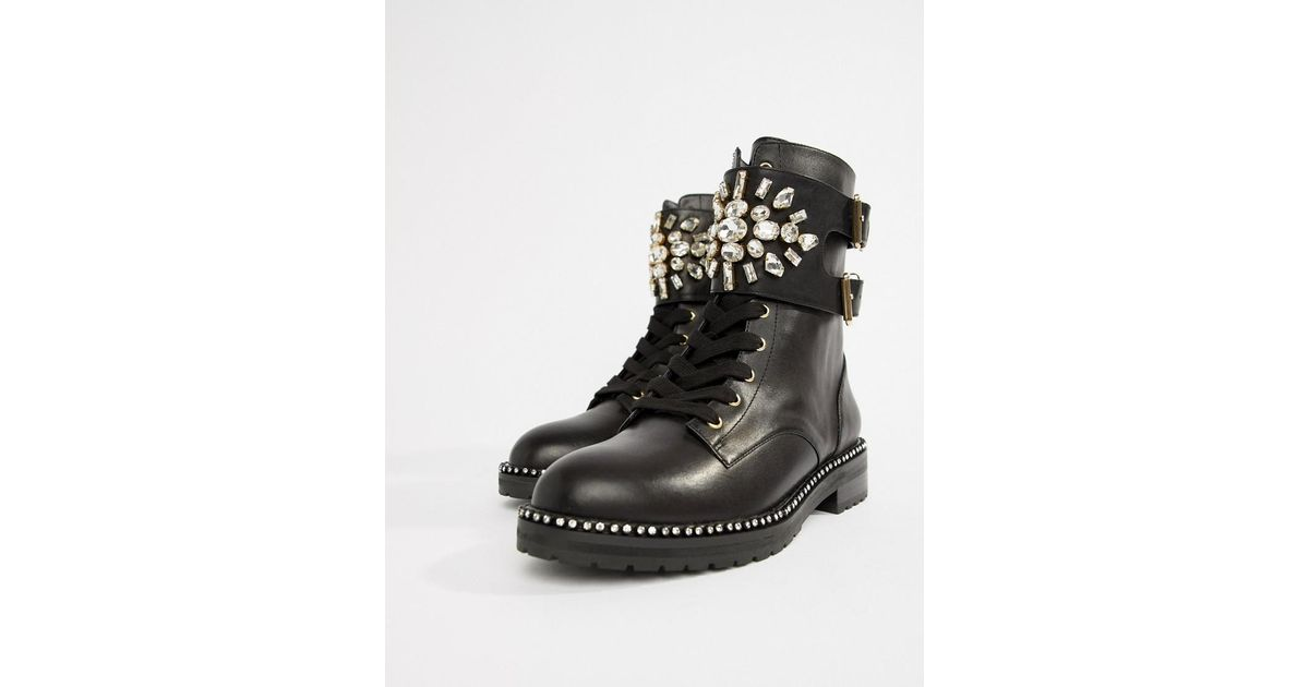 17d7fb9fa3e3 Kurt Geiger Kurt Geiger Stoop Black Leather Flat Ankle Boots With Studding  And Embellished Buckle Detail in Black - Lyst
