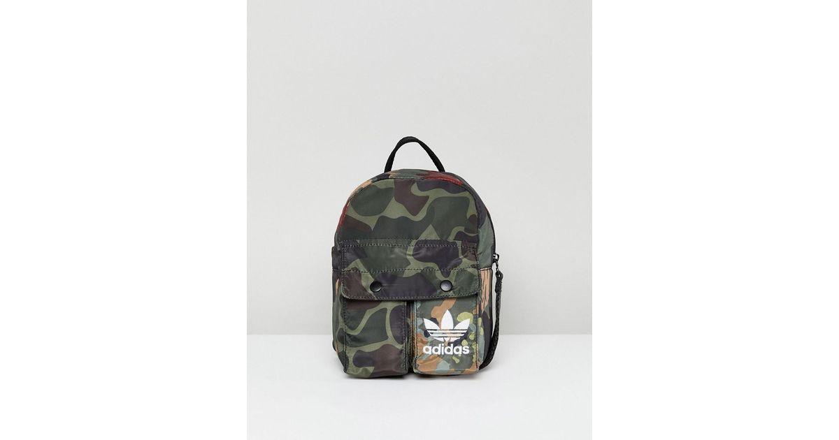 f38e8d215aa7 Lyst - adidas Originals X Pharrell Williams Hu Camo Mini Backpack