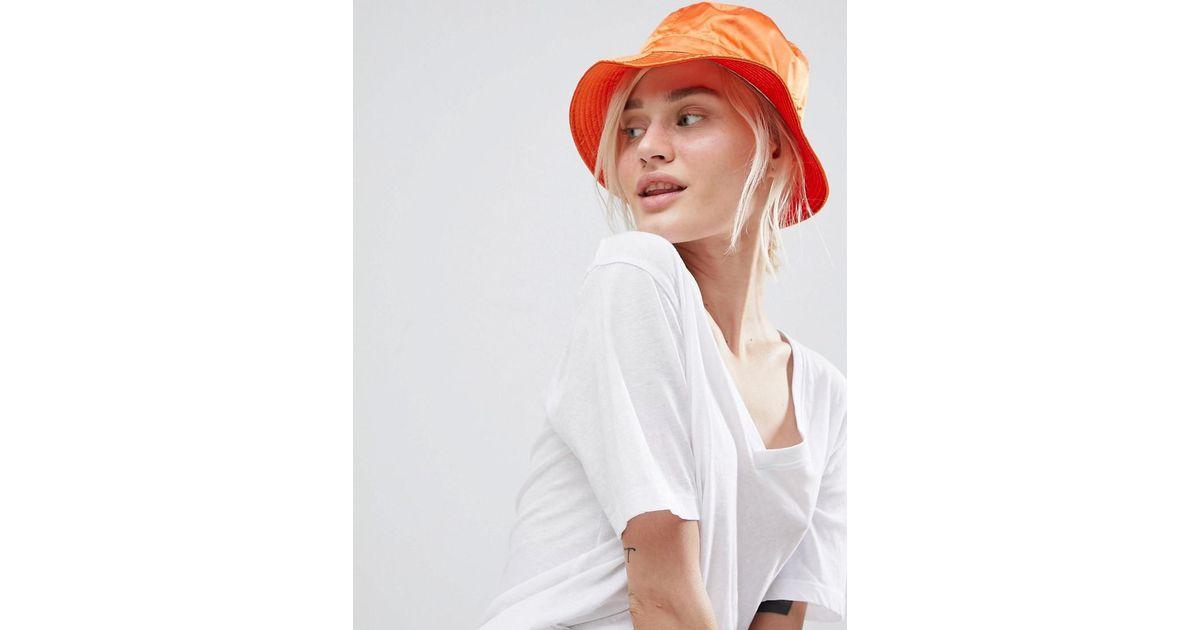 c0373b5903378 Lyst - ASOS Satin Bucket Hat in Orange