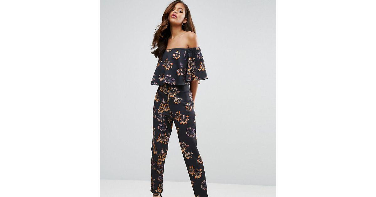 3e3ba9e7222 Lyst - ASOS Scuba Jumpsuit With Ruffle Bardot In Winter Floral Print in  Black