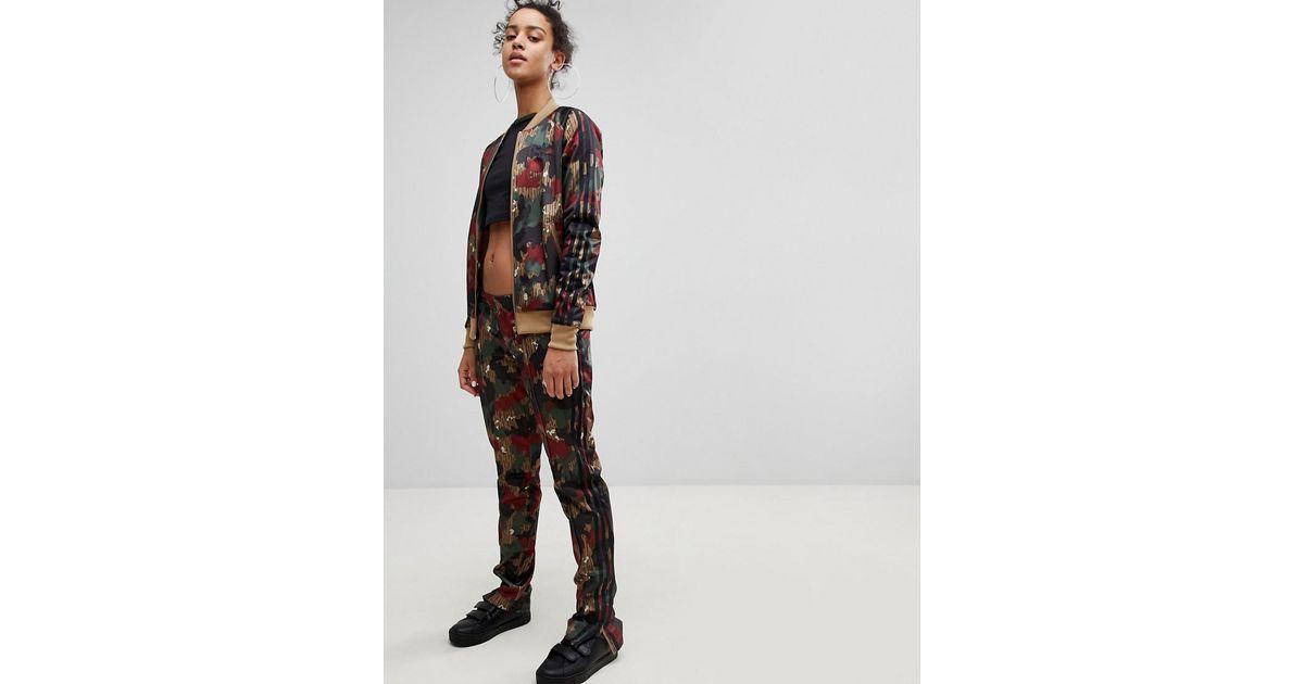 f3e8c319bb Lyst - adidas Originals Originals X Pharrell Williams Hu Camo Track Pants  in Black