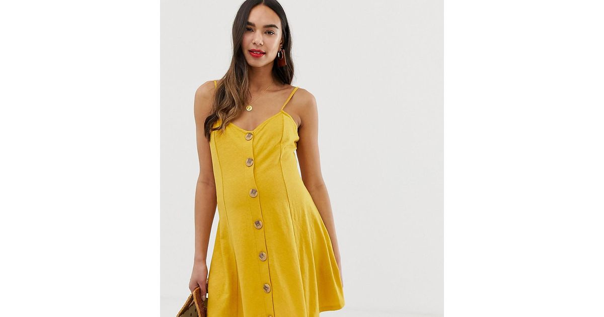 7eae61f000d Lyst - ASOS Asos Design Maternity Mini Slubby Cami Swing Dress With Faux  Wood Buttons in Yellow