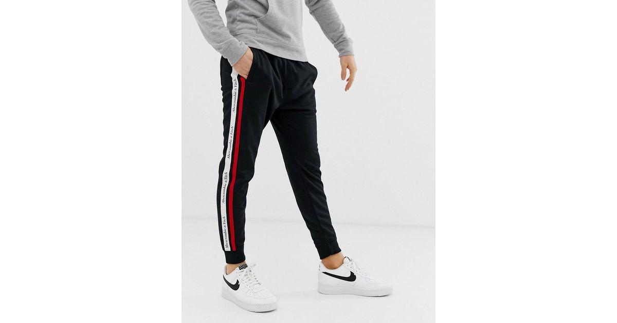 44ec91823 Lyst - Joggers negros con bajo ajustado de punto con cinta lateral con el  logo de Abercrombie & Fitch de hombre de color Negro