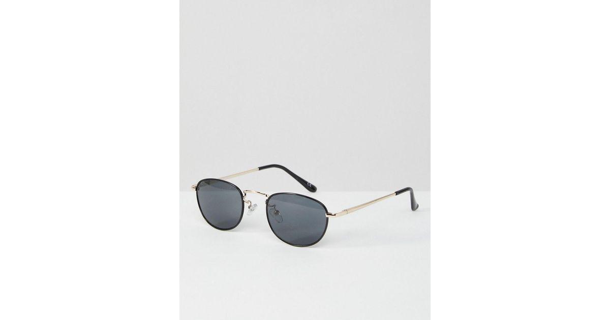 Lyst - Petites lunettes de soleil ovales avec pont mtallique argent style  90 s Asos en coloris Noir 7a89d39a7e41
