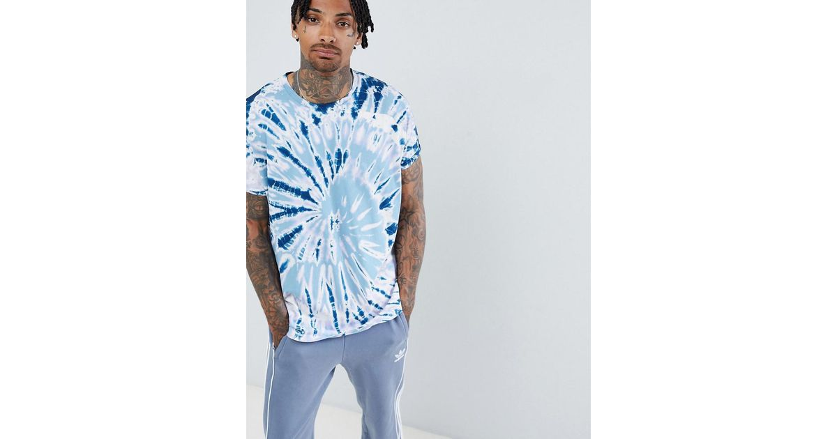 bfd9672a67eff8 ASOS Oversized Longline T-shirt With Roll Sleeve And Spiral Tie Dye In Blue  in Blue for Men - Lyst