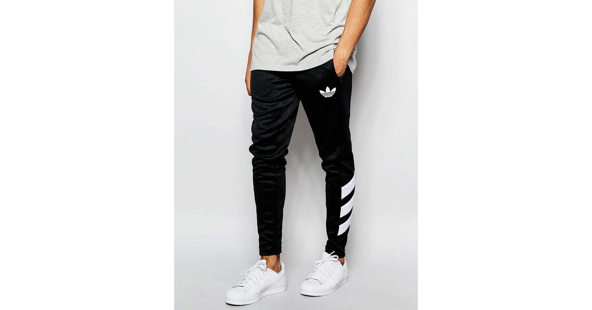 buy popular 29fbd b10e9 adidas Originals Skinny Striped Joggers in Black for Men - Lyst