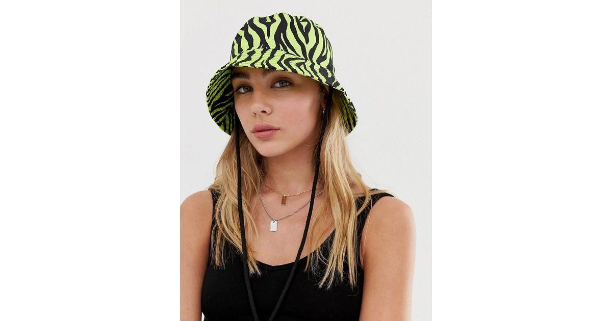 257e697ab9015 Lyst - ASOS Neon Zebra Bucket Hat in Green