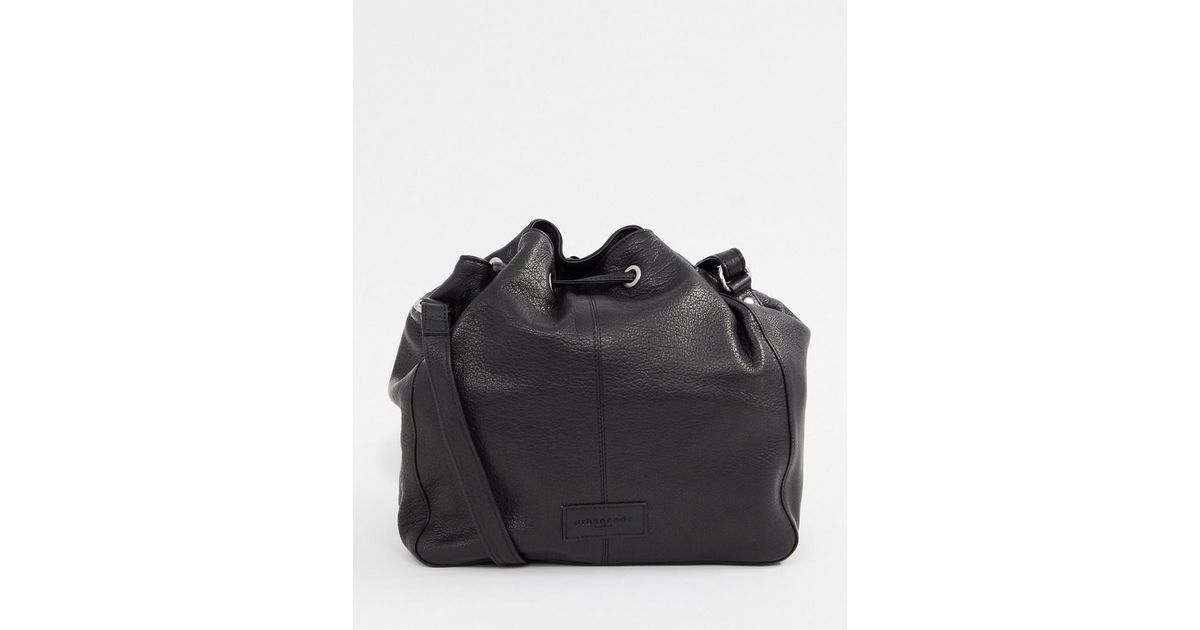 3c7f903f7e34 Urbancode Leather Drawstring Bucket Bag With Cross Body Strap in Black -  Lyst