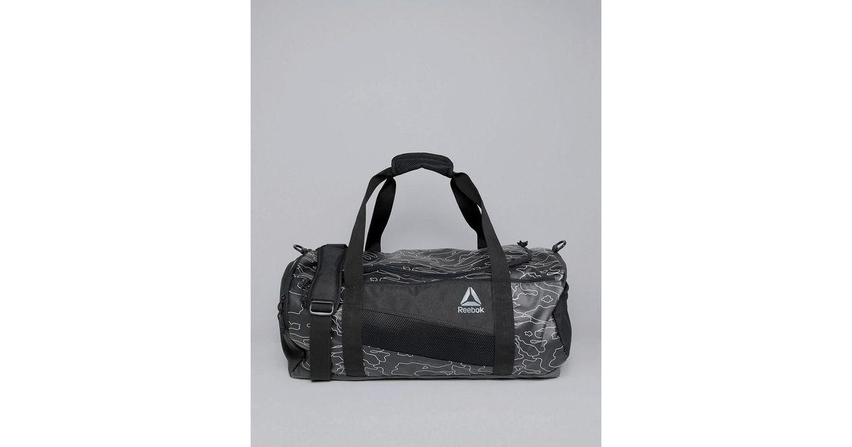 055ce243c831 Reebok Training Active Enhanced 48l Holdall Bag In Black Camo Print Cz9816  in Black for Men - Lyst