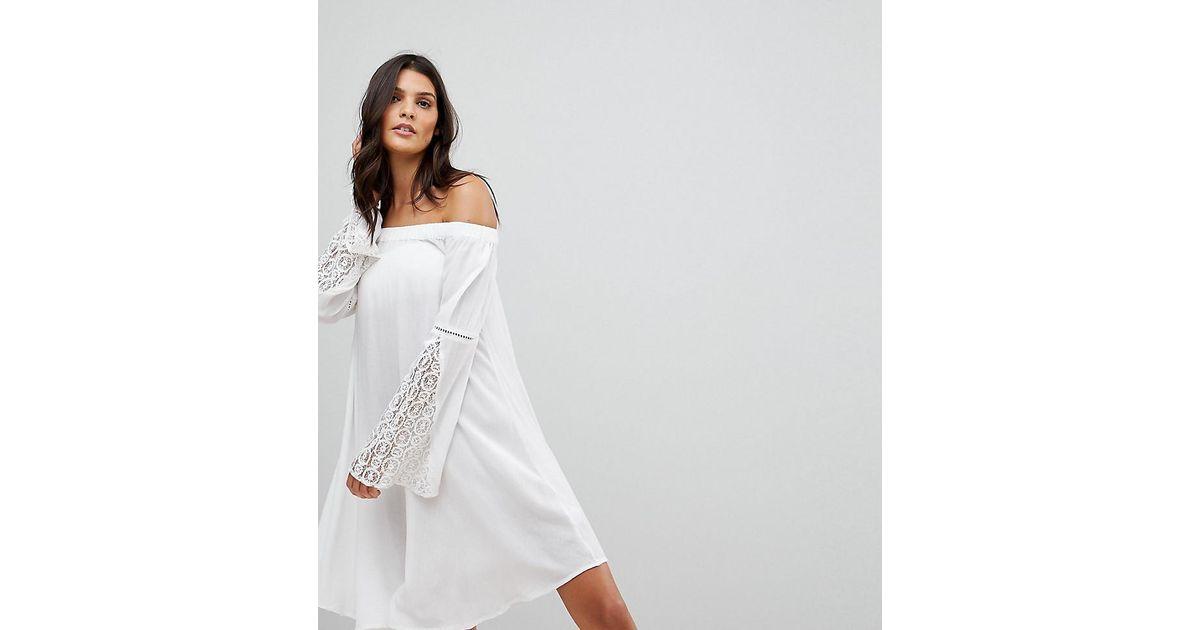 fe7482e644 Akasa Crochet Trim Fluted Sleeve Off Beach Dress in White - Lyst