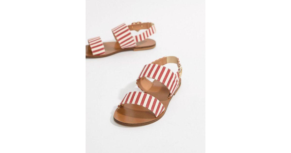 3566bd7fd865 Lyst - Love Moschino Stripe Flat Sandals in Red