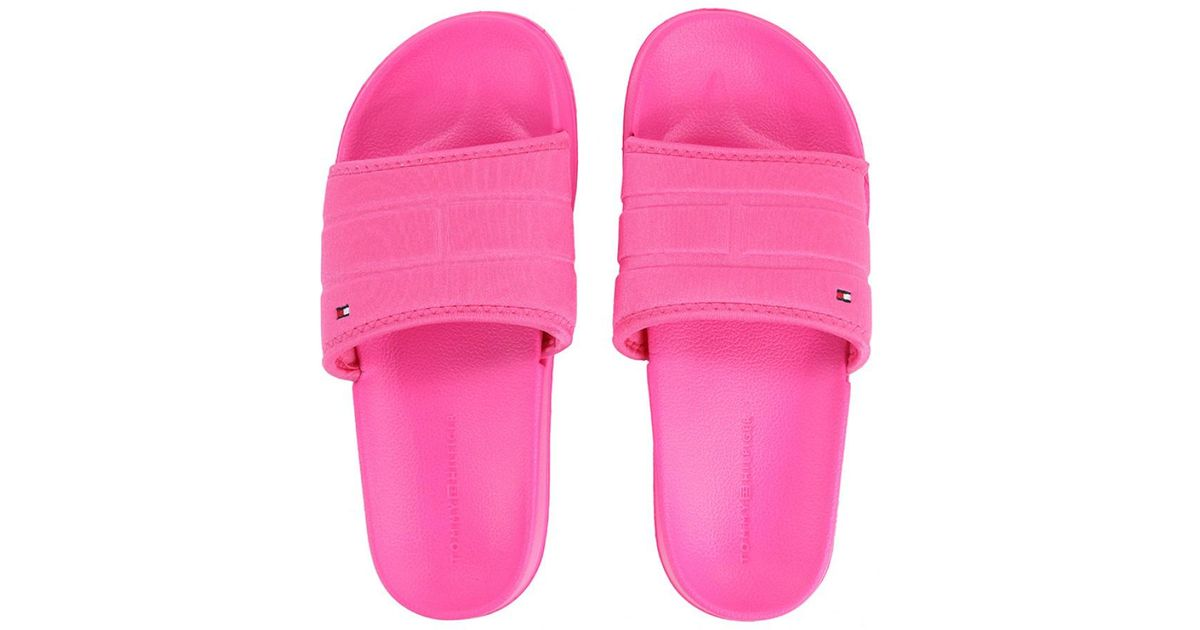 46fd904b8 Lyst - Tommy Hilfiger Women s Corporate Flag Pool Slide Flip Flop in Pink