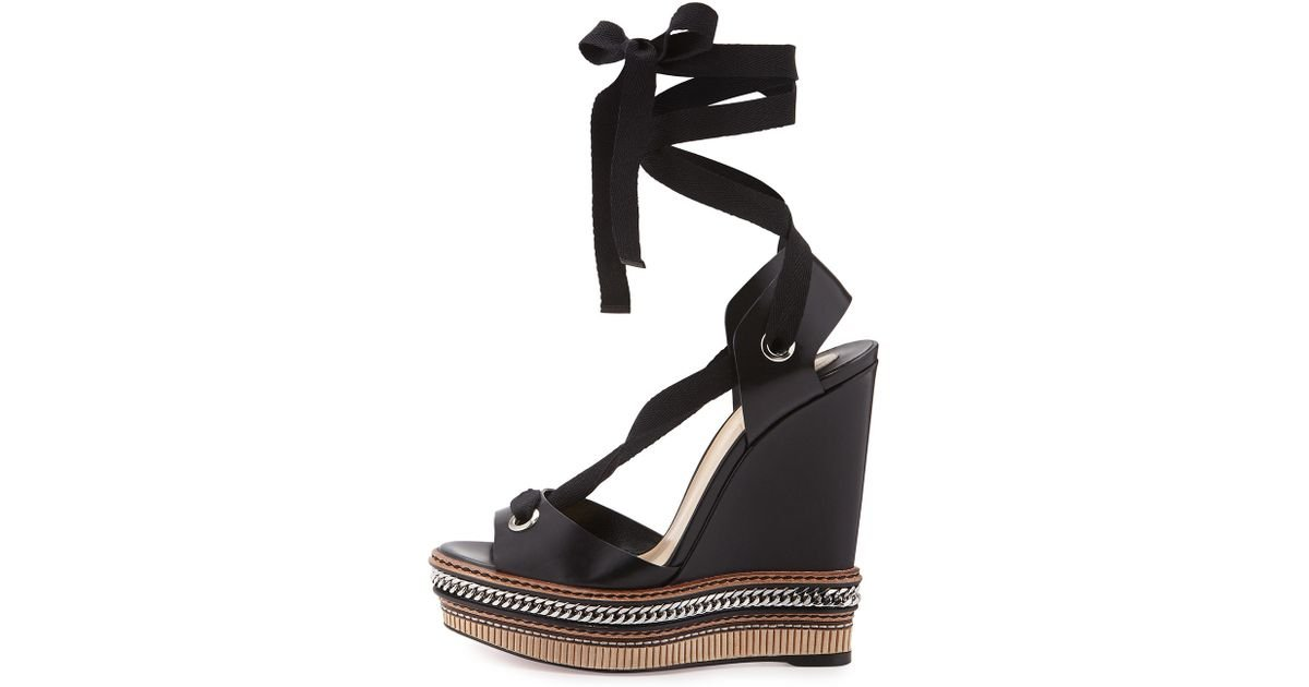 ee8538fbd7a7 Lyst - Christian Louboutin Tribuli Lace-up Red Sole Wedge Sandal in Black