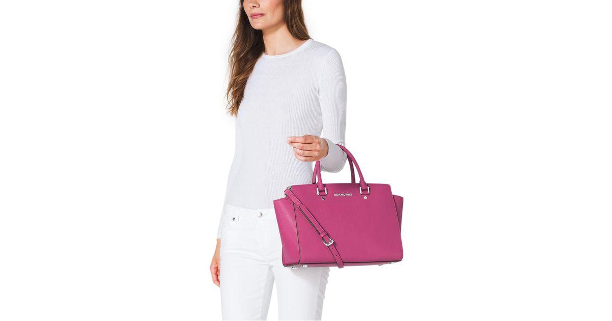 907c55e184 netherlands michael kors deep pink handbag 924ab c1778