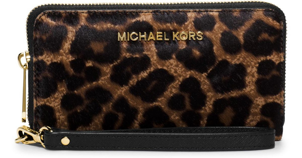 00f861f325f6 ... new zealand lyst michael kors jet set travel large leopard calf hair  smartphone wristlet 3e606 6257a