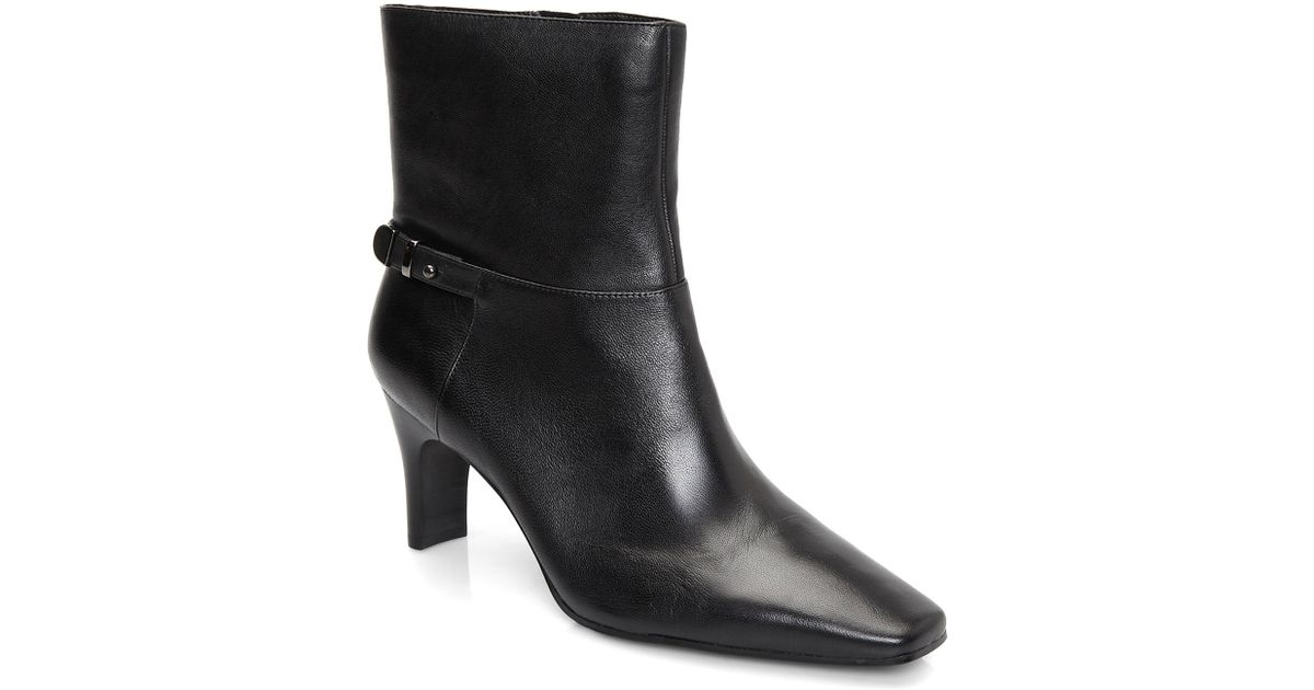 5761f180f788 Lyst - Bandolino Embellish Black Ankle Boots in Black