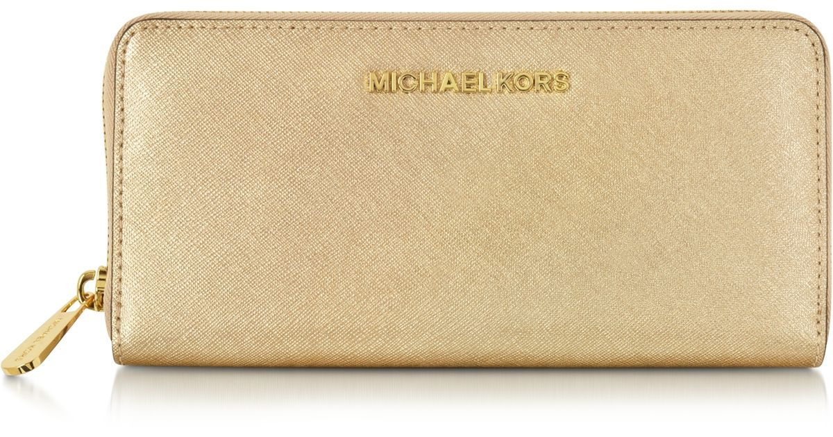 6470bd807b5a Michael Kors Jet Set Travel Pale Gold Saffiano Leather Continental Wallet  in Metallic - Lyst