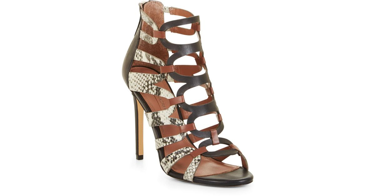 95484f61687c Lyst - BCBGMAXAZRIA Bcbg Valentia Python Leather Sandals