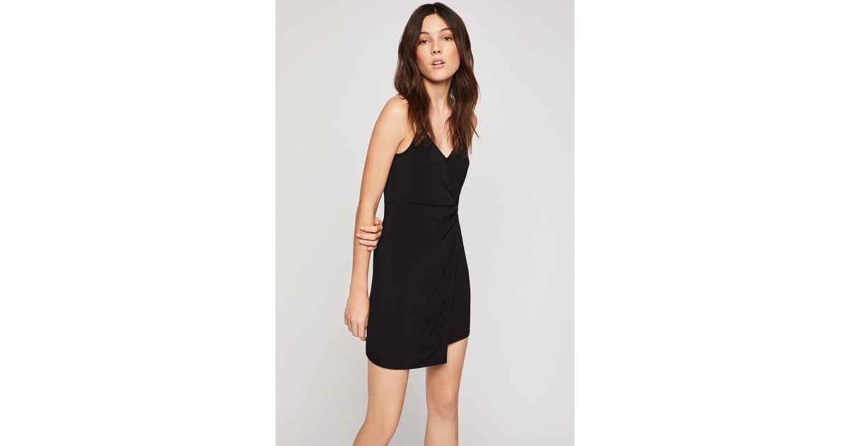 5c7f517c8e4 BCBGeneration Twist-front Surplice Dress in Black - Lyst
